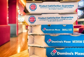 Half Off Pizzas at Dominos This Week